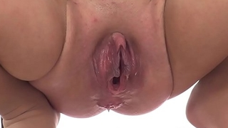 Slut fucks her pussy and ass with toy