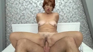 Mature redhead fucked by a stud