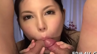 Eye-catching japanese darling pleases with soaked blow job