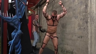 Bondage sub deepthroating hunks dick outdoors