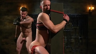 Bound stud gagged and flogged in sexdungeon