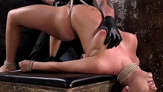 Big-busted bondage submissive gets flogged