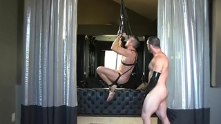 Spandex BDSM brace gets handjob from dom hunk